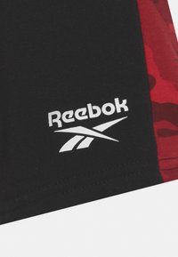 Reebok - CAMO - Tracksuit bottoms - red - 2