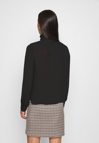 Vero Moda - VMZIGGA HIGH NECK SMOCK - Button-down blouse - black
