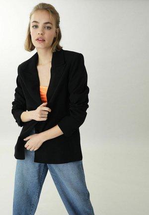 Krátký kabát - schwarz