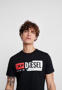 Diesel - DIEGO CUTY - Print T-shirt - black - 3