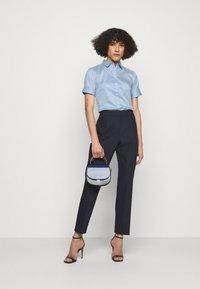 HUGO - ESHILA - Button-down blouse - light pastel blue - 1