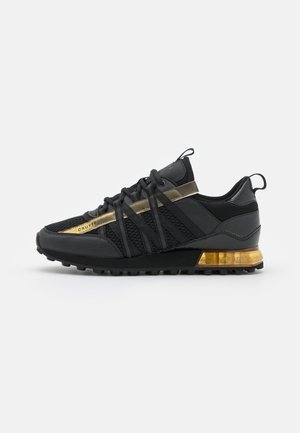 FEARIA - Zapatillas - black/gold
