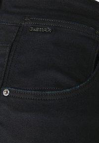 G-Star - STRINGFIELD ULTRA HIGH SKINNY WMN - Jeans Skinny Fit - black metalloid cobler - 2