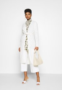 JDY - JDYGURLI BELT CARDIGAN - Strickjacke - off-white