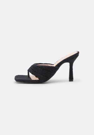 NIYAH - T-bar sandals - black