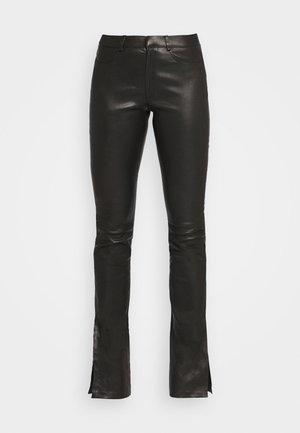 LUCILLE - Kožené kalhoty - black