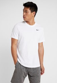 Nike Performance - DRY TEE CREW SOLID - Basic T-shirt - white/black - 0