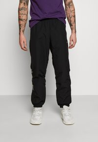 adidas Originals - FOOTBALL GRAPHIC TRACK PANTS - Verryttelyhousut - black - 0