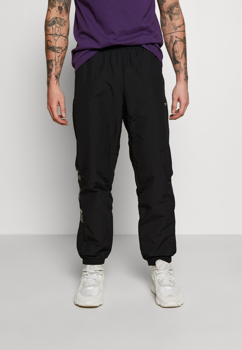 adidas Originals - FOOTBALL GRAPHIC TRACK PANTS - Verryttelyhousut - black
