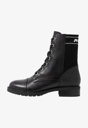 OHSOMICKEY DISNEY - Veterboots - black