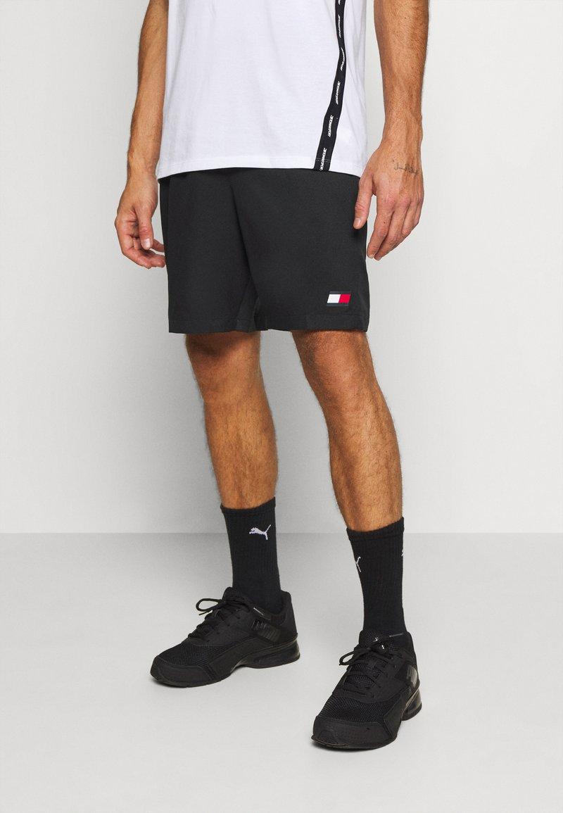 Tommy Hilfiger - LOGO FLAG SHORT - Sports shorts - black