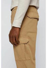 BOSS - Cargo trousers - beige - 3