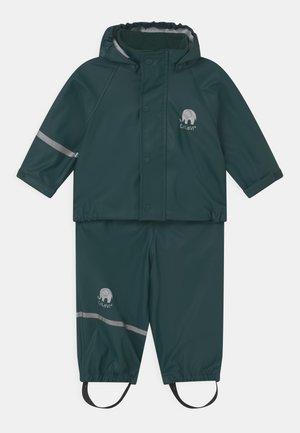 SET UNISEX - Waterproof jacket - pondorosa pine