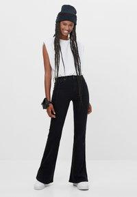 Bershka - Bootcut jeans - black - 1