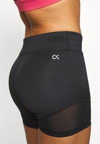 Calvin Klein Performance - SHORT - Leggings - black - 3