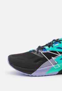 New Balance - PROPEL - Neutral running shoes - black - 5