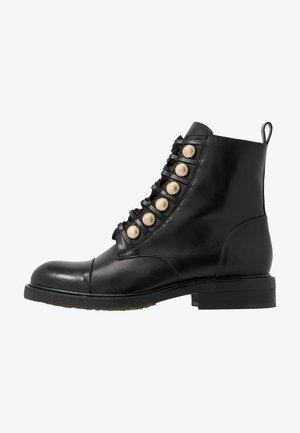Bottines à lacets - black/gold