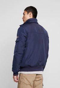 Tommy Jeans - TECH JACKET - Winter jacket - black iris - 4