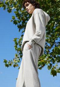 Nike Sportswear - Tracksuit bottoms - beige - 2