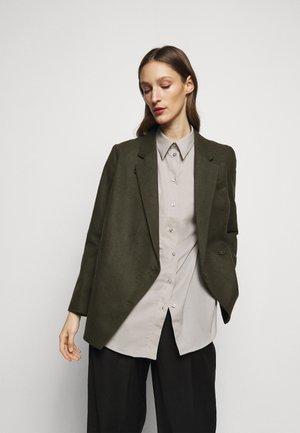 ANISSA - Lehká bunda - dark green