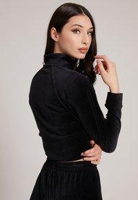 Guess - Zip-up sweatshirt - schwarz - 2
