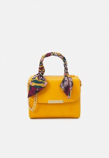Across body bag - moutarde