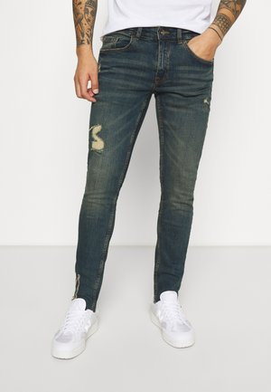 STOCKHOLM DESTROY - Jeansy Slim Fit - egyptian blue