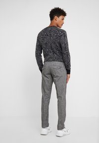 DRYKORN - Trousers - mottled grey - 2