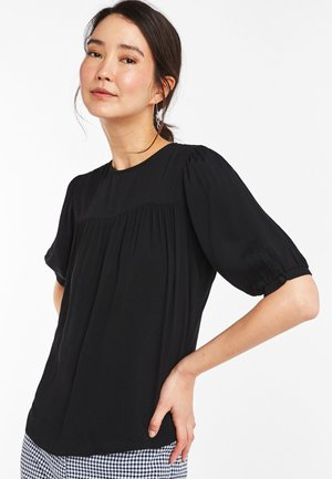 ORANGE DITSY - Blouse - black