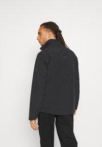 Mammut - TROVAT HOODED JACKET  - Hardshell jacket - black - 3
