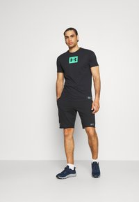 Under Armour - BOXED ALL ATHLETES - Print T-shirt - black - 1