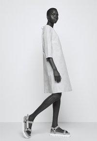 Marimekko - CLASSICS HAVAITTU PIKKU LOKKI DRESS - Day dress - blue/sand - 3