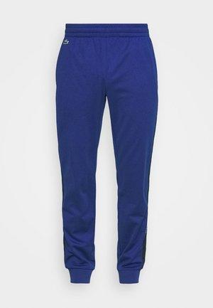 TENNIS PANT BLOCK - Teplákové kalhoty - cosmic/navy blue/white