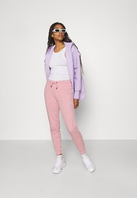 Nike Sportswear - TIGHT - Tracksuit bottoms - pink glaze/white - 1