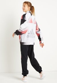 adidas Performance - Training jacket - white/signal pink/black - 3