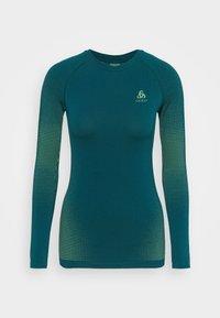 ODLO - CREW NECK PERFORMANCE WARM - Sports shirt - submerged - 3