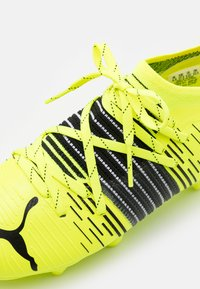 Puma - FUTURE Z 2.1 FG/AG JR UNISEX - Moulded stud football boots - yellow alert/black/white - 5
