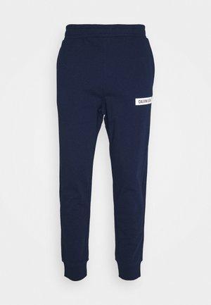 PANTS - Spodnie treningowe - blue
