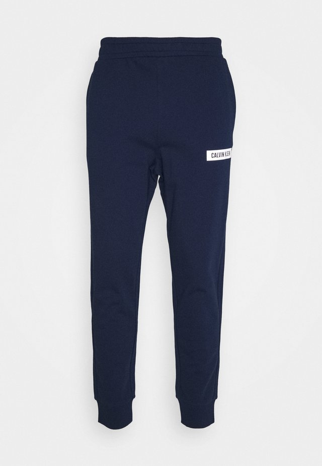 PANTS - Trainingsbroek - blue