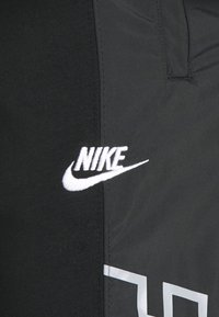 Nike Sportswear - Tracksuit bottoms - black/particle grey/white - 2