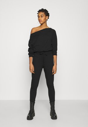 SWEAT - OFF-SHOULDER LONG SLEEVES CINTERED JUMPSUIT - Haalari - black