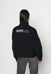 Nike Sportswear - AIR - Chaqueta de entrenamiento - black - 2