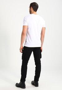 Schott - TRRANGER - Cargo trousers - black - 2