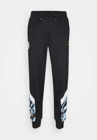 Puma - MANCHESTER CITY ICONIC GRAPHIC TRACK PANTS - Tracksuit bottoms - black/spectra yellow - 0
