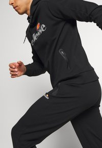 Ellesse - OSTERIA - Tracksuit bottoms - black - 3