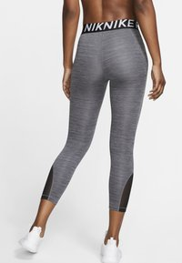 Nike Performance - CROP - Legginsy - black, dark grey - 1