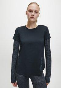 Calvin Klein - T-shirt sportiva - black - 0