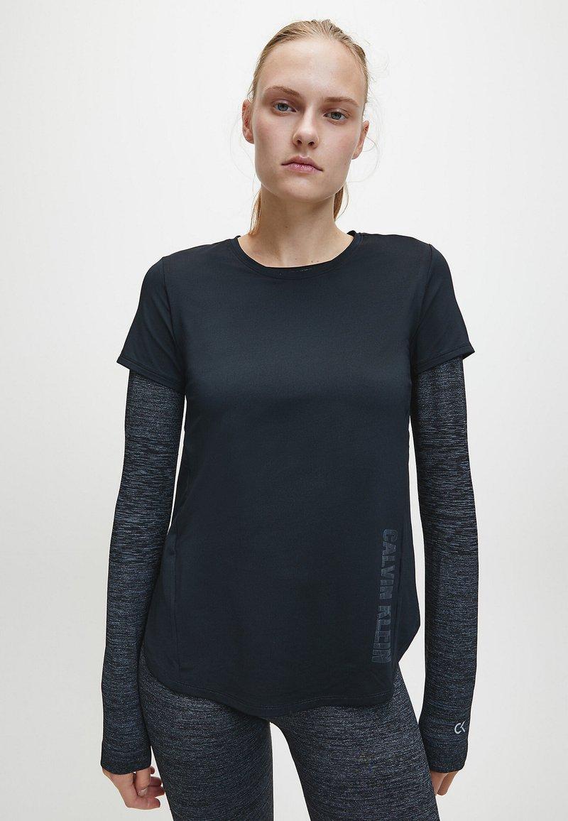 Calvin Klein - T-shirt sportiva - black