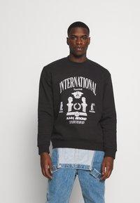 Nominal - INTERNATIONAL CREW - Sweatshirt - black - 0