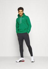 Champion - HOODED  - Sweatshirt - green - 1